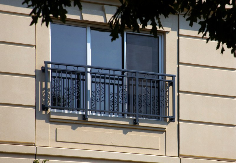 French Balcony in the Modern Interpretation and Decoration. Modern block of flats with french window