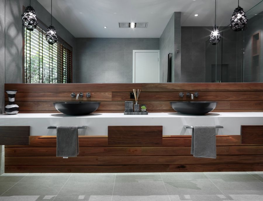 Black Bathroom Interior Design Ideas with Photos and Remodeling Advice. Large mirror and wooden trimmed sink zone