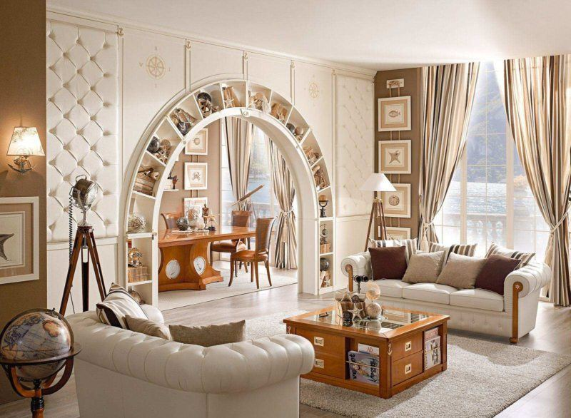 Unusual design of the arch in the living room containing shelves for books