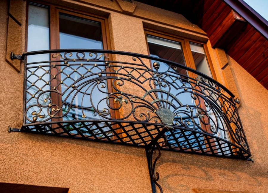French Balcony in the Modern Interpretation and Decoration. Nice wrought iron fence on two French windows at once