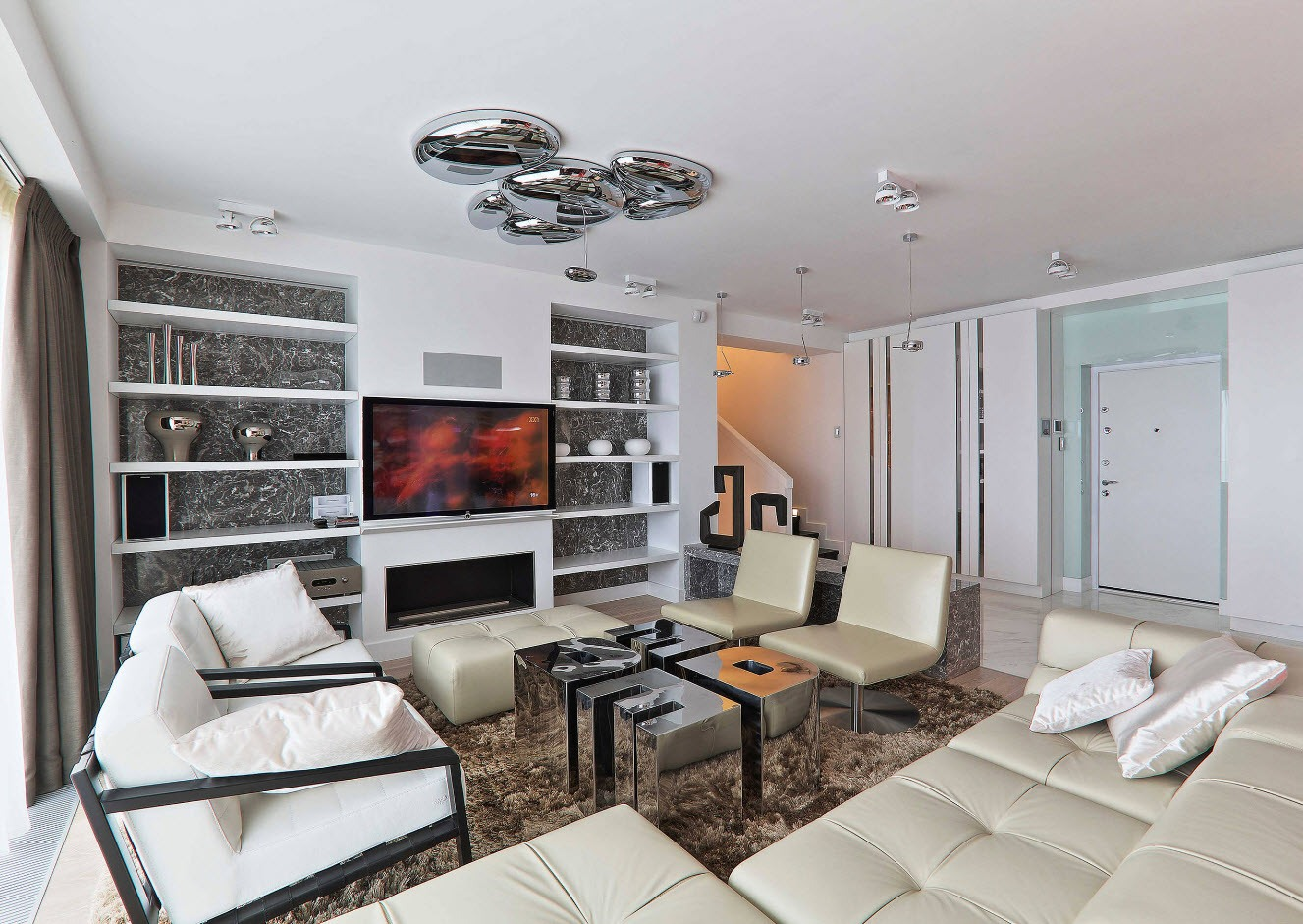 White Living Room: Different Style Interiors with Photos. Silver lamps and built-in shelves at the accent wall