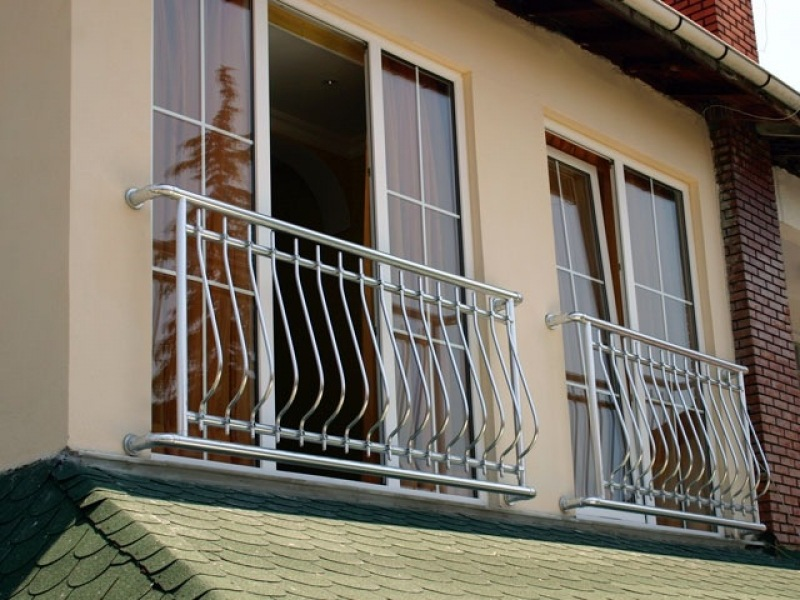 French Balcony in the Modern Interpretation and Decoration. Modern cottage with french balconies at the guest bedrooms
