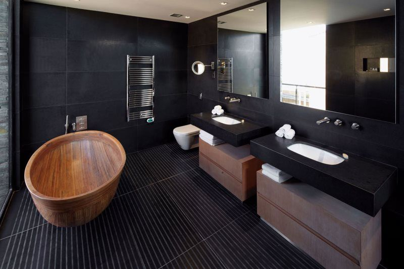 Black Bathroom Interior Design Ideas with Photos and Remodeling Advice. Tile and wood combination