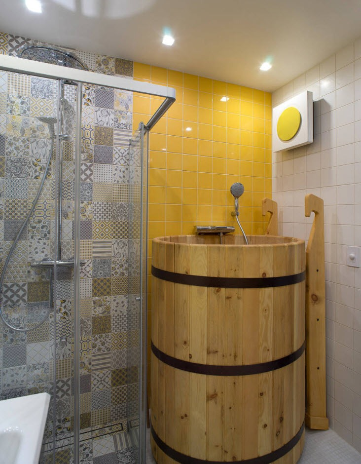 Bathroom Wall Finishing Materials Overview. Open shower and tub for bathing in the bathroom with yellow painted walls
