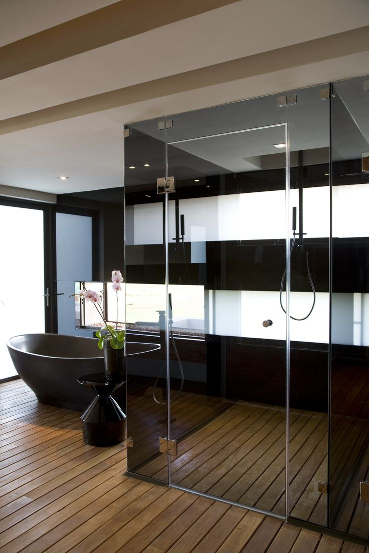 Black and white bathroom with wooden floor