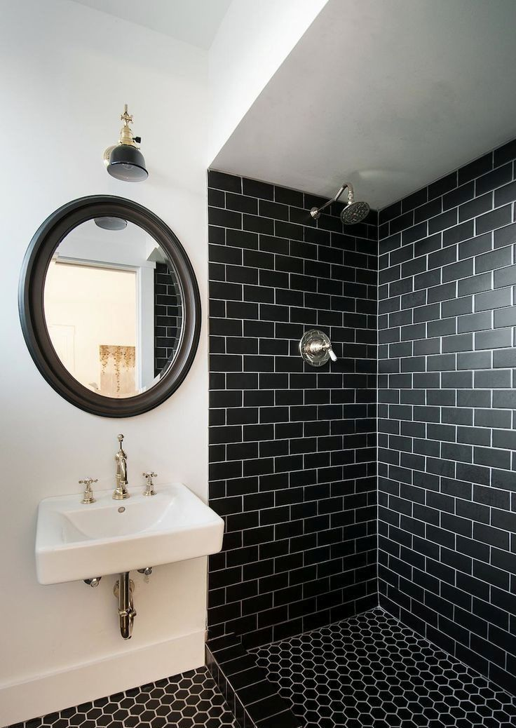 Black Bathroom Interior Design Ideas with Photos and Remodeling Advice. Another round mirror and black metro tile