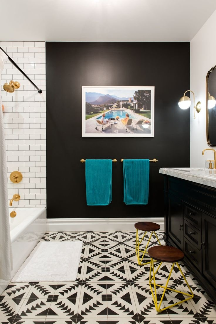 Black Bathroom Interior Design Ideas with Photos and Remodeling Advice. Turquoise towels look juicy at the black wall