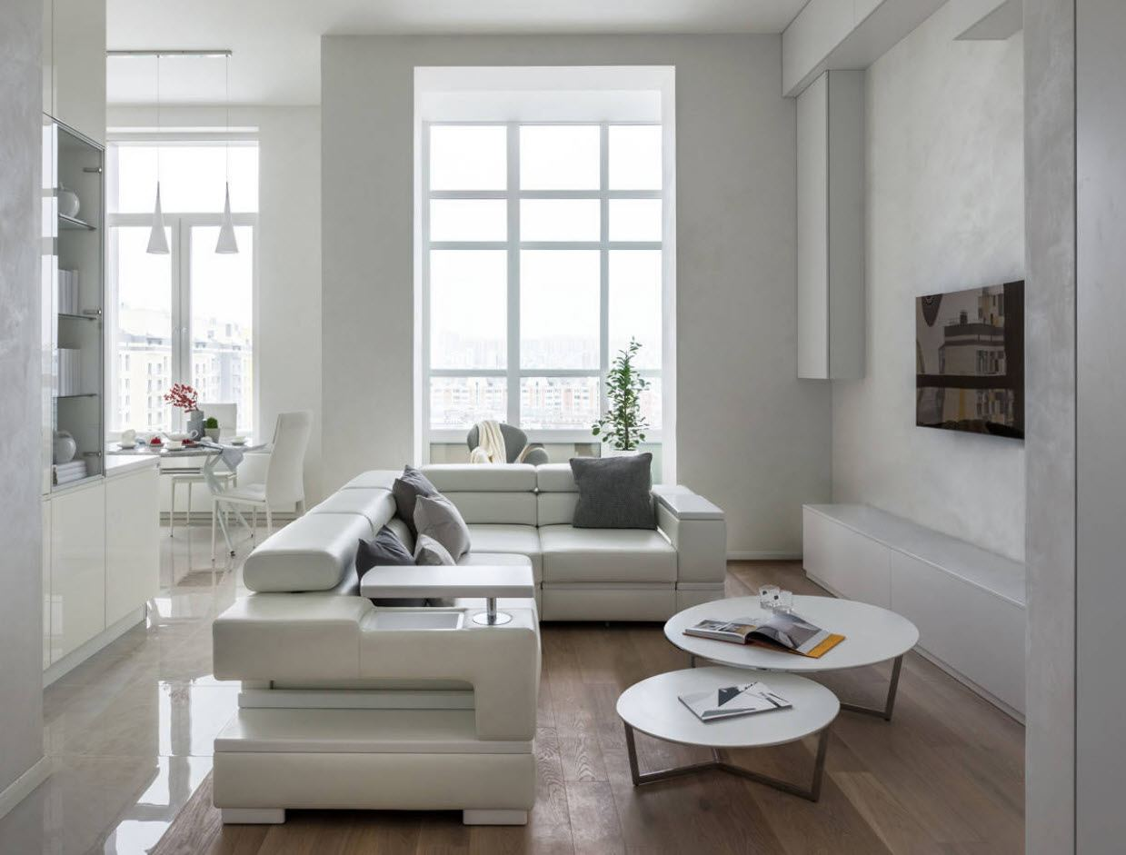 White Living Room: Different Style Interiors with Photos. Modern leather angular sofa adn wooden floor for great designed living