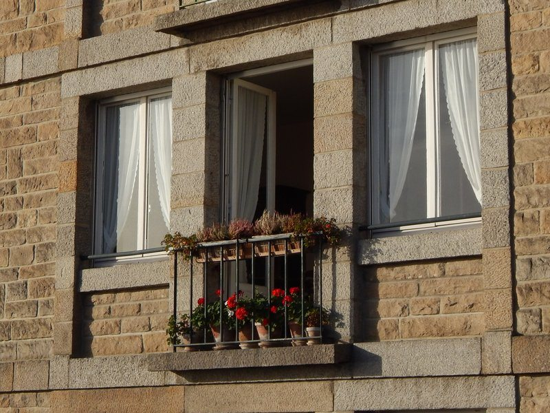 Mediterranean house facade with flowers