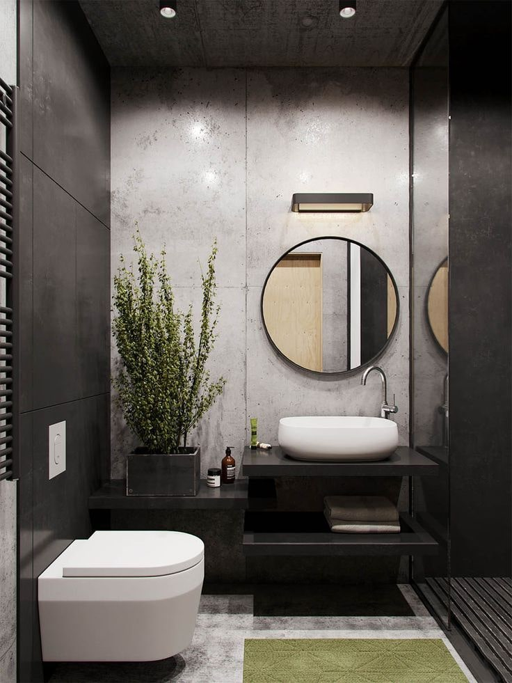Black Bathroom Interior Design Ideas with Photos and Remodeling Advice. Nice designed modern bathroom with gray accent wall and round mirror