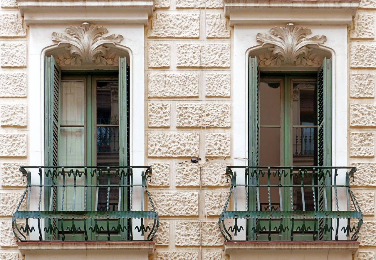 Classic designed exterior of the house with neat forged French balconies