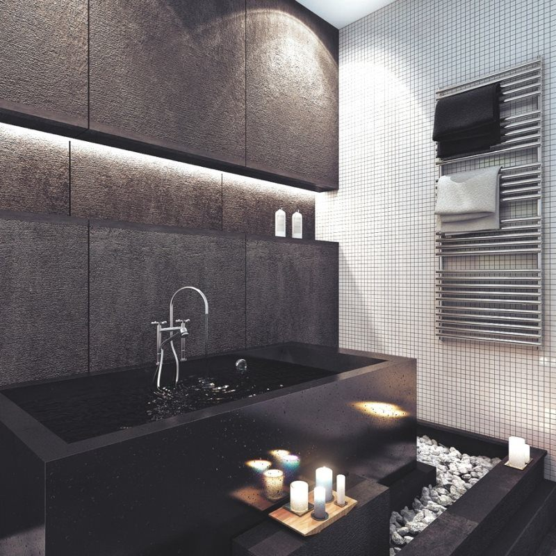 Modern designed black bathroom with candles and pebble decoration