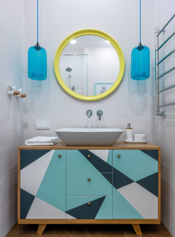 Yellow framed mirror and bright pattern of the vanity facade