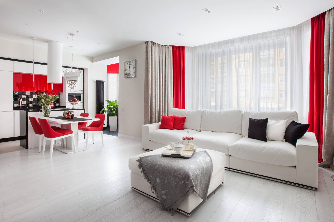 White Living Room: Different Style Interiors with Photos. Red additions to the nicely decorated open area apartment