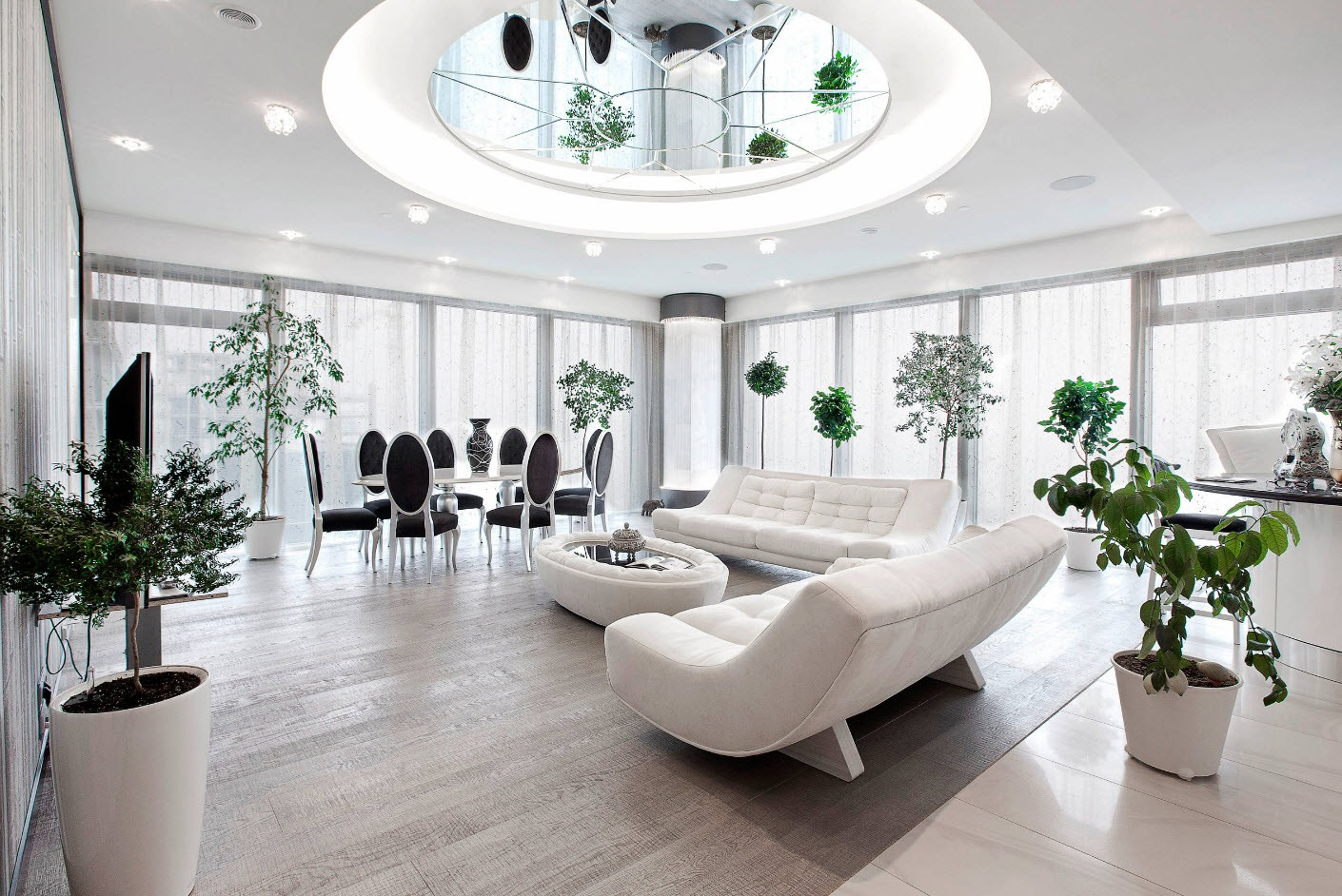 Ultramodern rich living room with smooth lines of the sofas and round installation with lighting at the ceiling