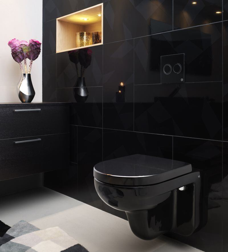 White floor tile and black walls to decorate the space