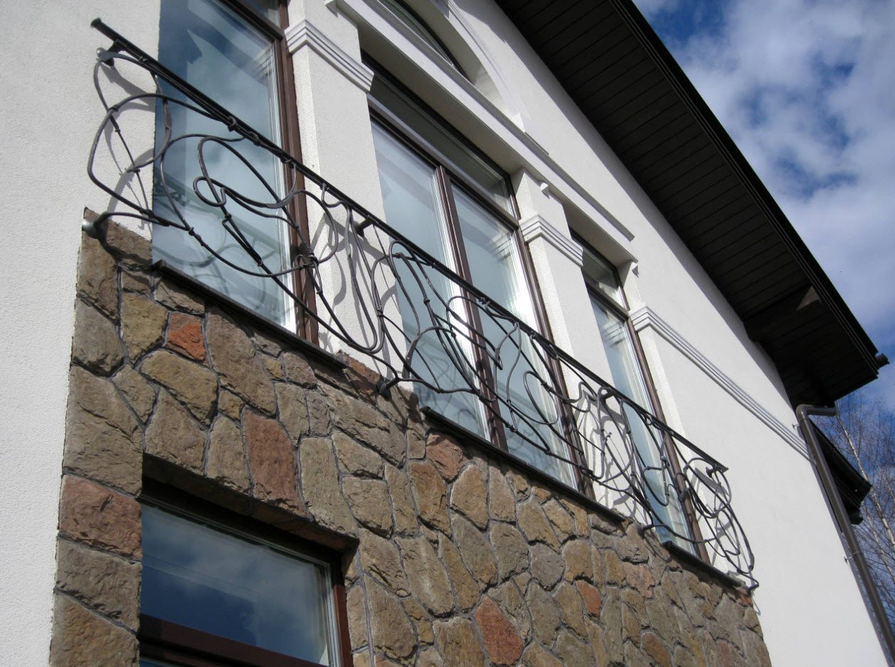 Panoramic French windows with forging