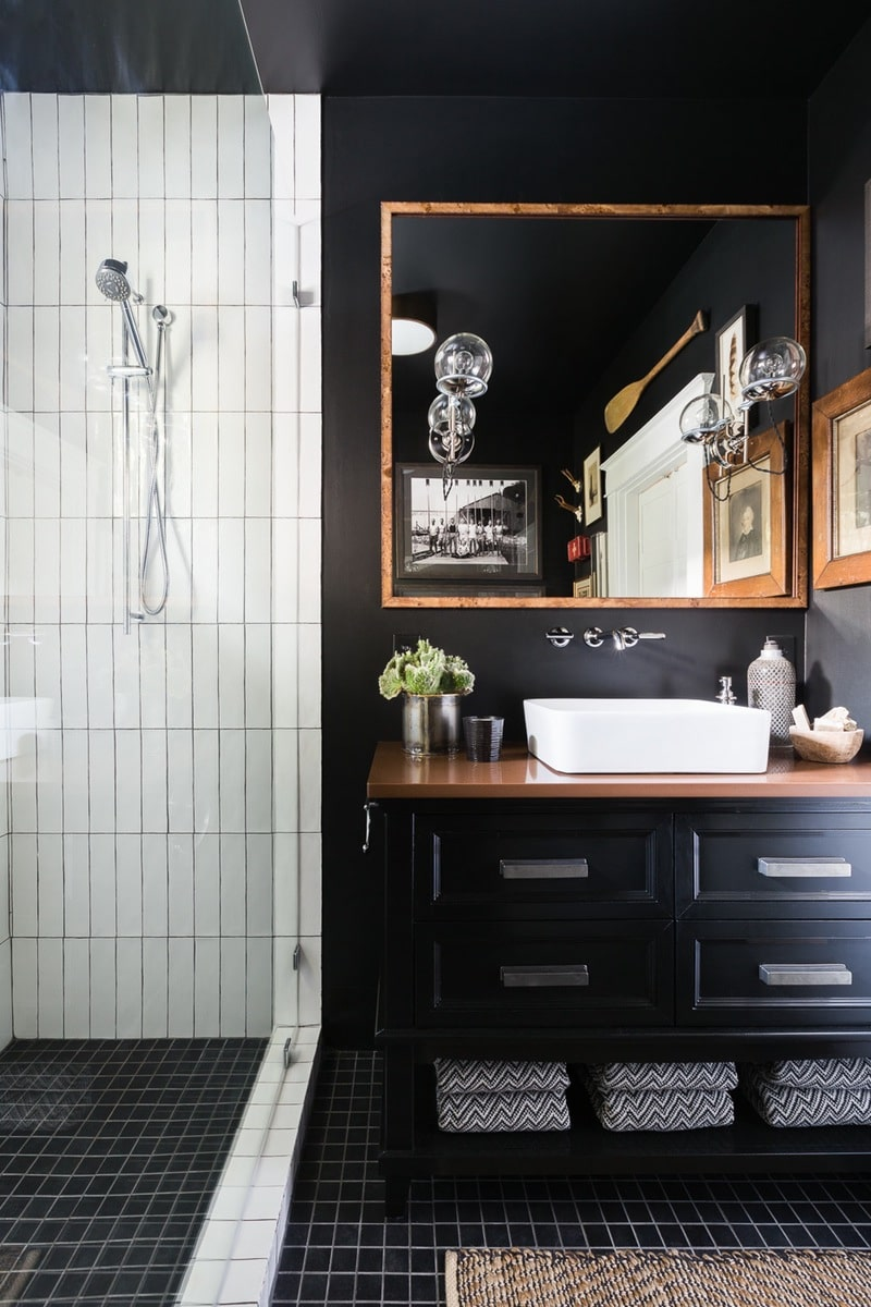 Black Bathroom Interior Design Ideas with Photos and Remodeling Advice. Classic designed bathroom with white tiled shower zone