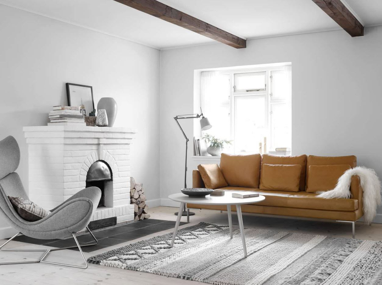 White Living Room: Different Style Interiors with Photos. Brown upholstered sofa in the large living with open ceiling beams