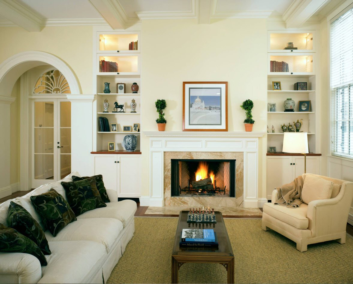 Arch in the Living Room: Unusual Design with Photos. Neat creamy white room with greenery and artificial fireplace