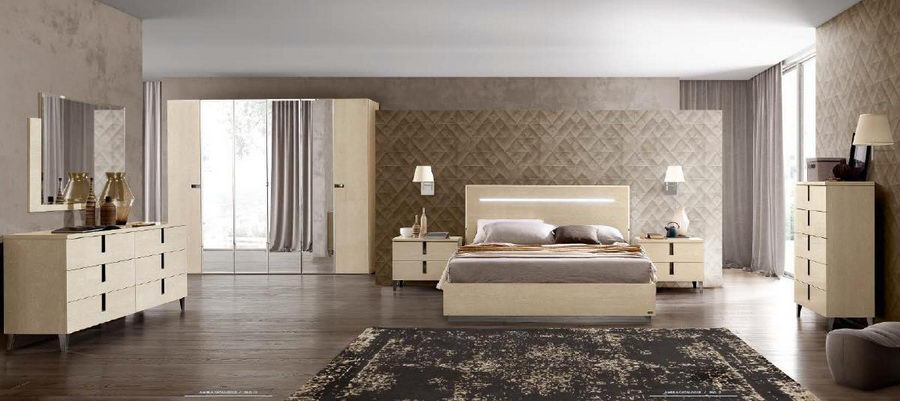 Large classic styled bedroom with the textured headboard wall and carpet