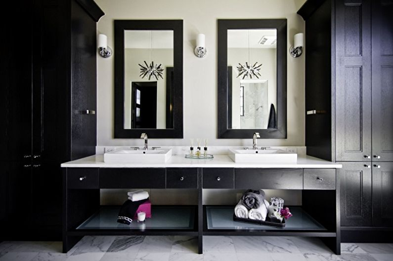 Black framed mirrors in the large casual bathroom for two