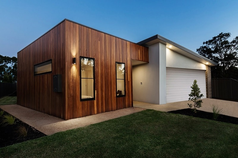 Different Types Of Modern Architectural Cladding Styles. Treated wooden exterior of the ultramodern house
