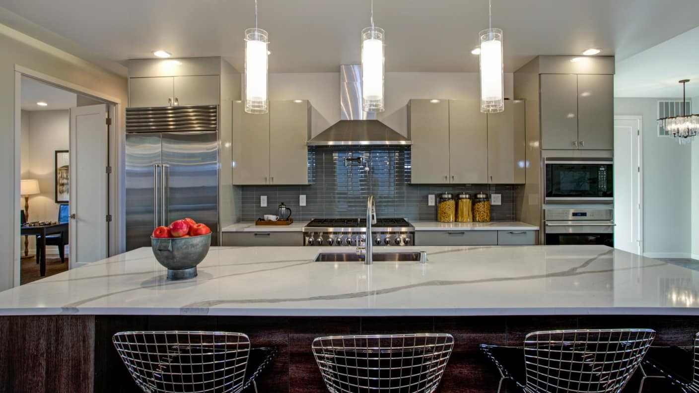 Why You Can'`t go wrong with Quartz in Your Kitchen. Modern kitchen interior with steel lattice chair