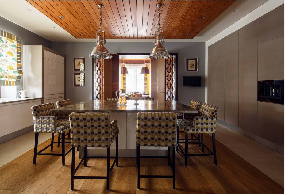 Private House Interior Finishing Ideas. Wooden planks of the ceiling and kitchen island as dining table