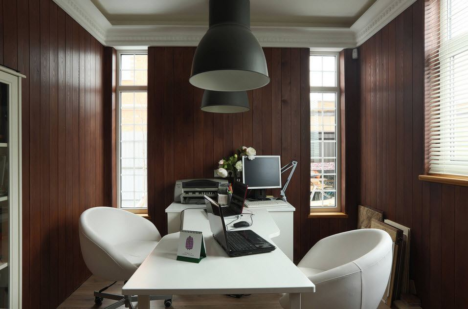 Dark wooden walls at the modern home office for two with white furniture