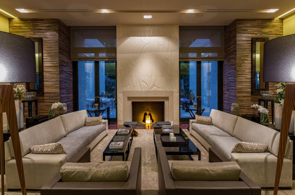 Dark finishing of the contemporary styled large living room with sitting zone and the fireplace