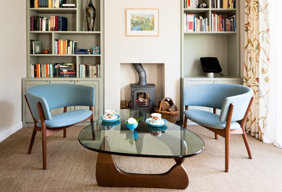1970s Interior Design Ideas with Photo Examples. Chamber fireplace and blue Scandi chairs