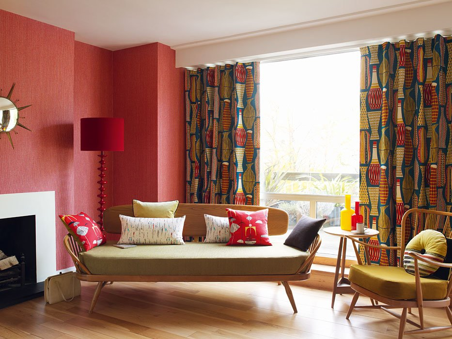 1970s Interior Design Ideas with Photo Examples. Red wallpaper and colored pattern on the curtains