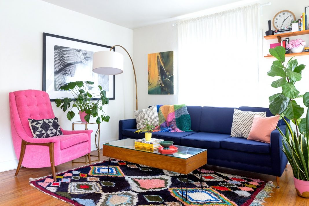 1970s Interior Design Ideas with Photo Examples. Colored rug and crimson armchair for pop-art living with blue sofa