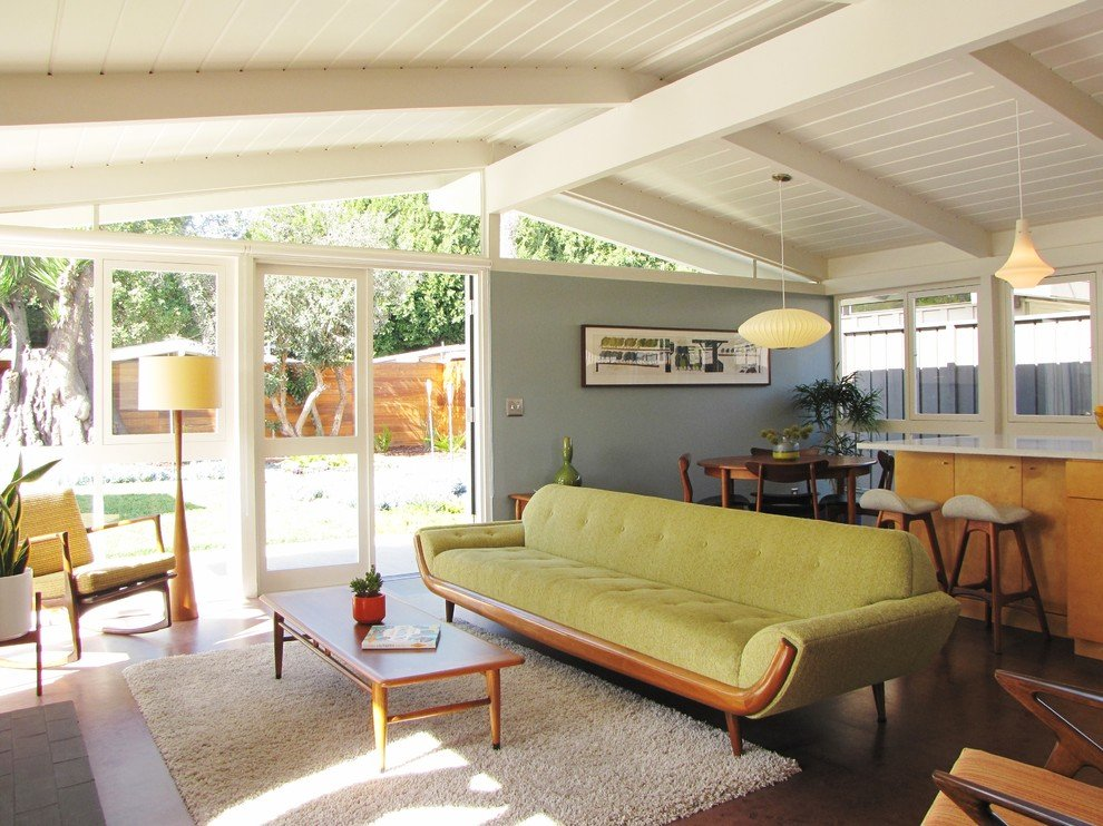 1970s Interior Design Ideas with Photo Examples. Green sofa for open space living at the cottage