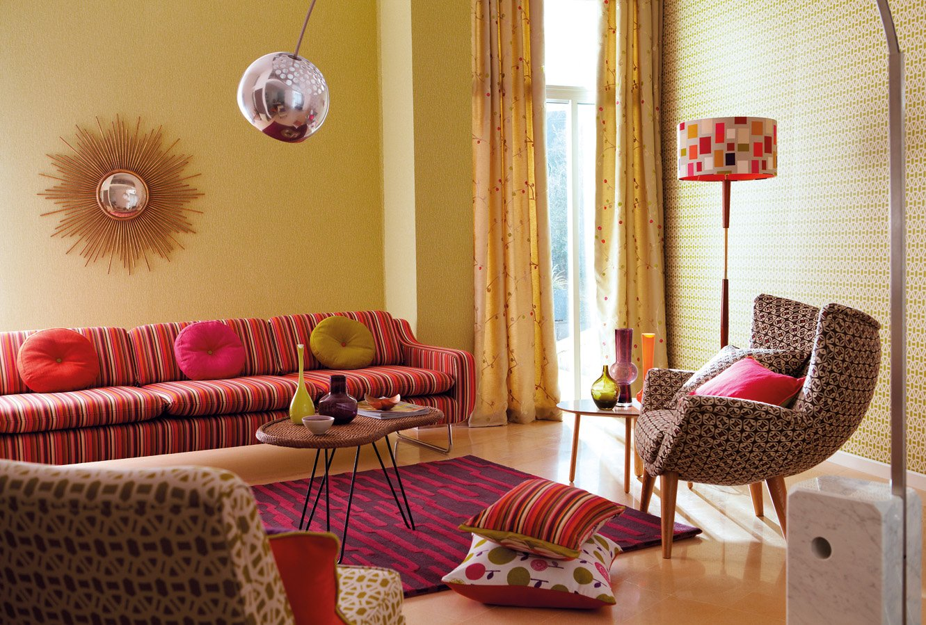 1970s Interior Design Ideas with Photo Examples. Unusual yellow walls for vintage room with spherical silver shade for lamp