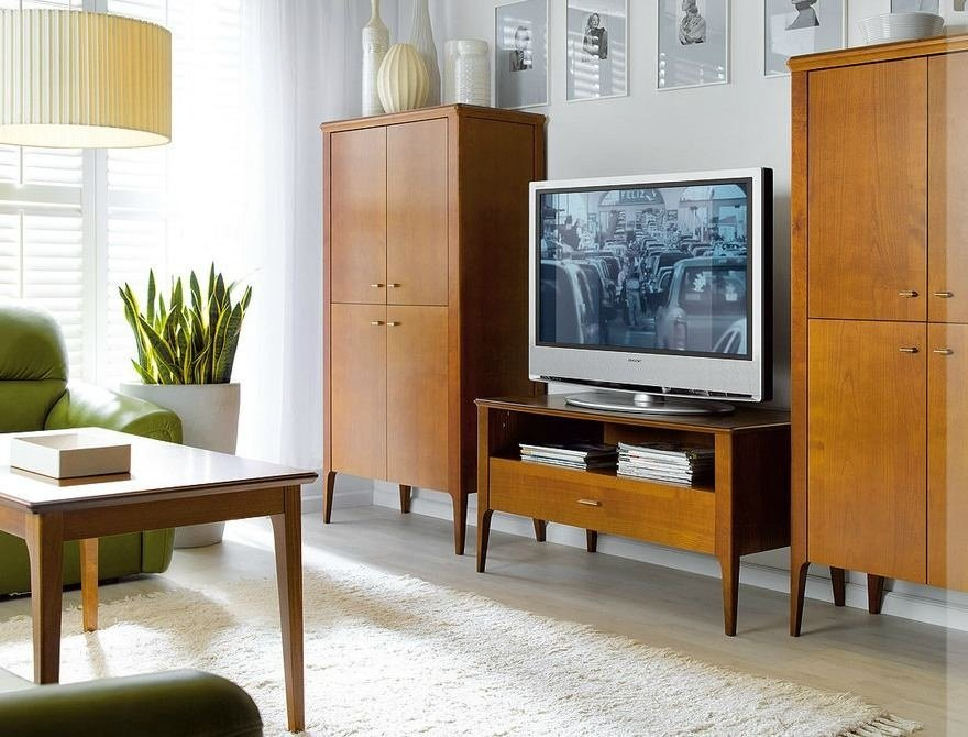 Typical 1980s interior with tv set on the chestboard and two cabinets at both sides