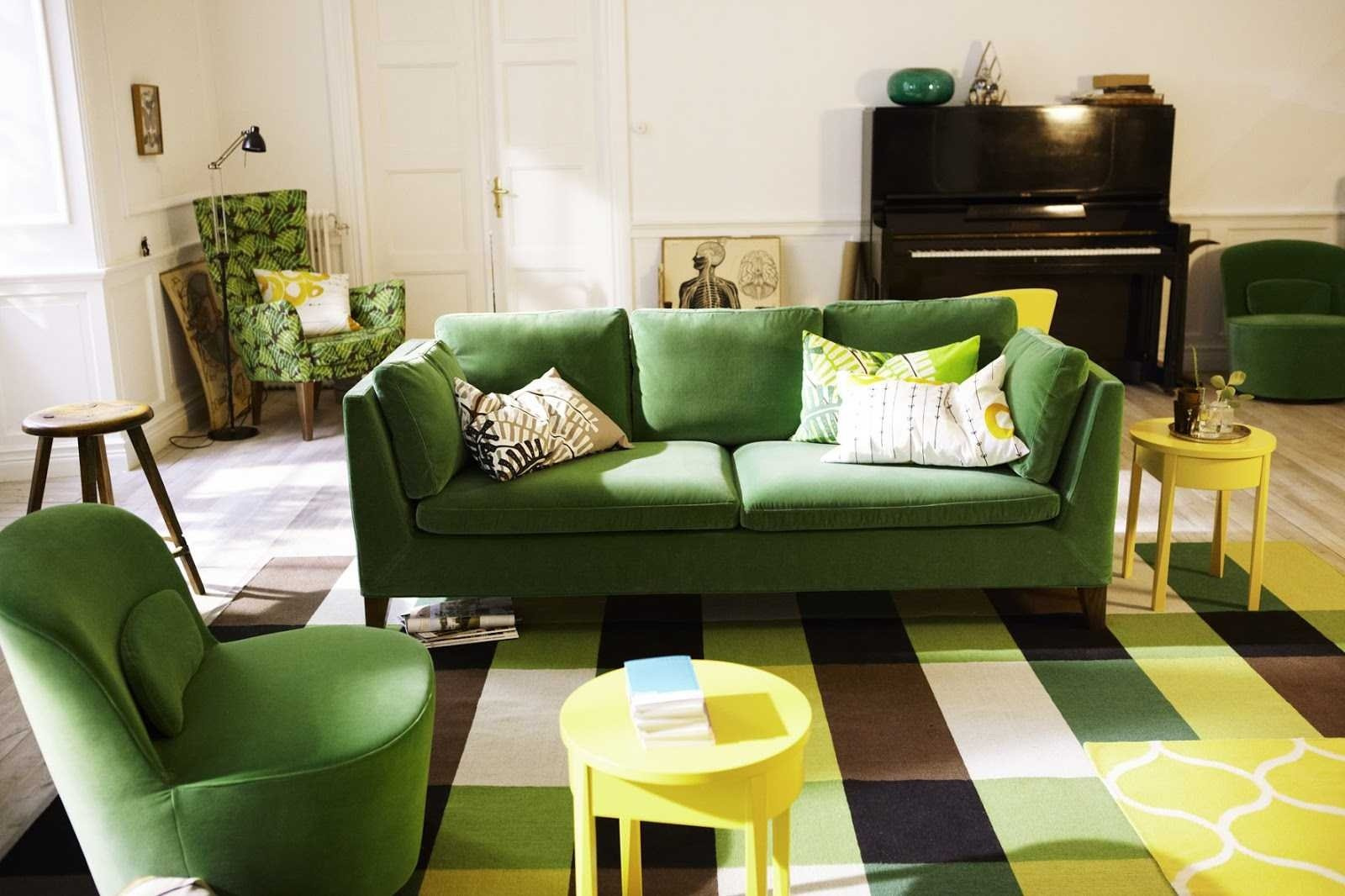 Unusual colored rug and green upholstered furniture for retro living
