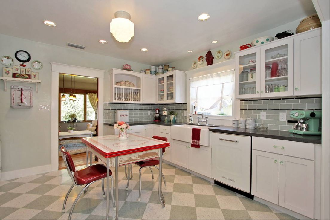 Retro styled kitchen with square large tiles on the floor