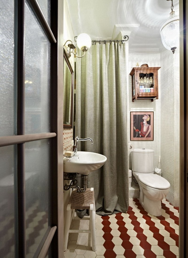 Retro styled toilet with rhombic tiled floor