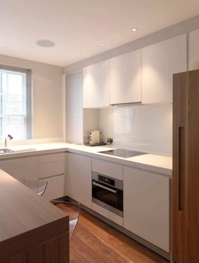 Kitchen Remodel: 3 Tips To Get More Space. Nice additional lighting and matte white facades