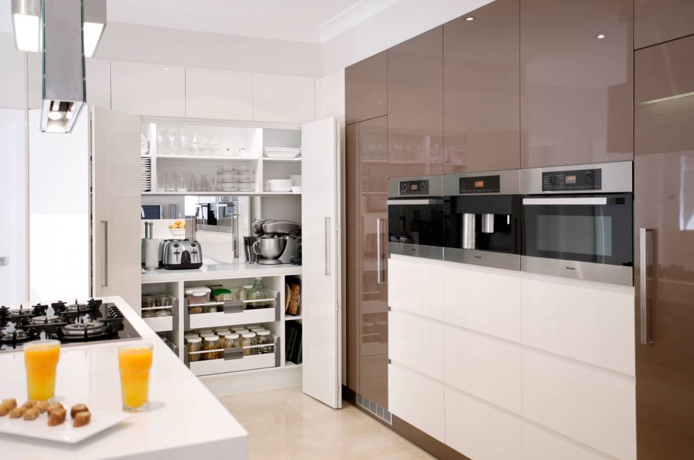 New Homeowner? Top 3 Places You Should Focus Your Design Efforts. Minimalistic modern functional kitchen with glossy surfaces