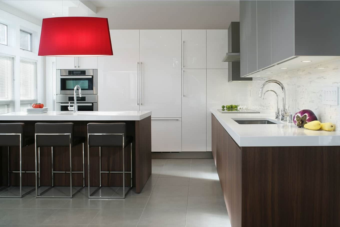 New Homeowner? Top 3 Places You Should Focus Your Design Efforts. Red chandelier and dark oak furniture facades at the casual kitchen