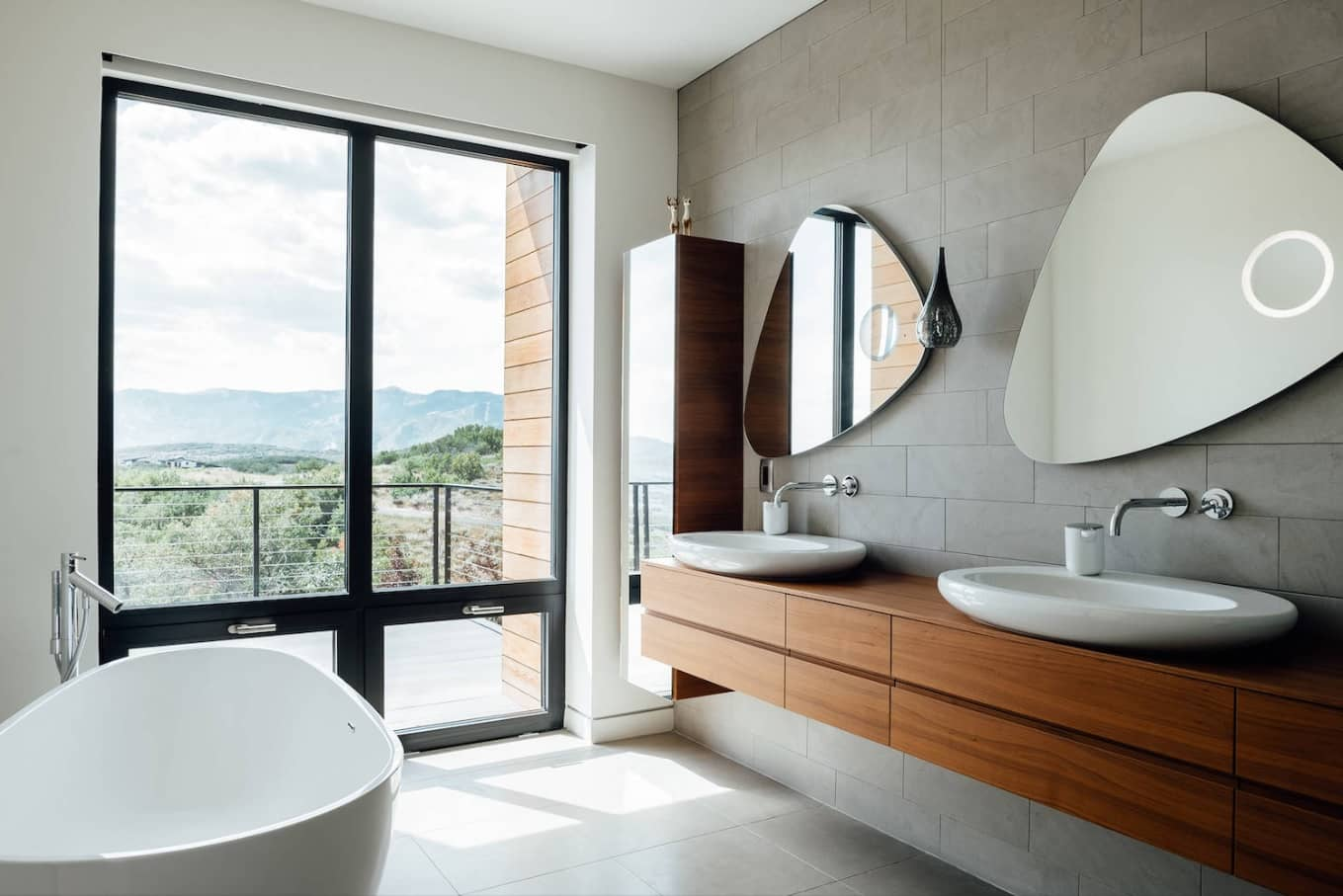 New Homeowner? Top 3 Places You Should Focus Your Design Efforts. Modern gray tiled large bathroom with hovering vanities