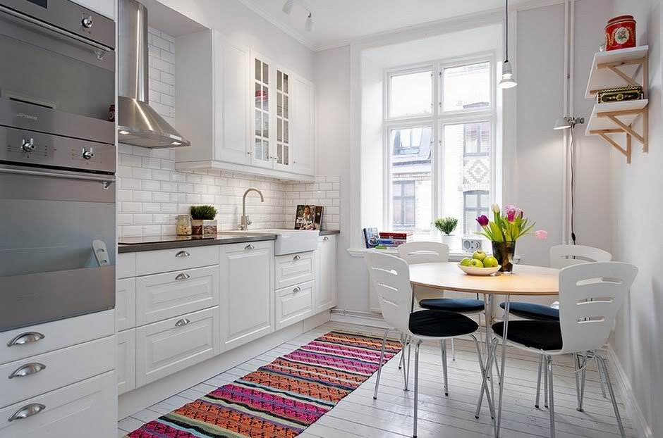 Scandinavian Style Kitchen: Interior Decoration and Furniture Ideas. Neat cozy interior with the colorful rug path