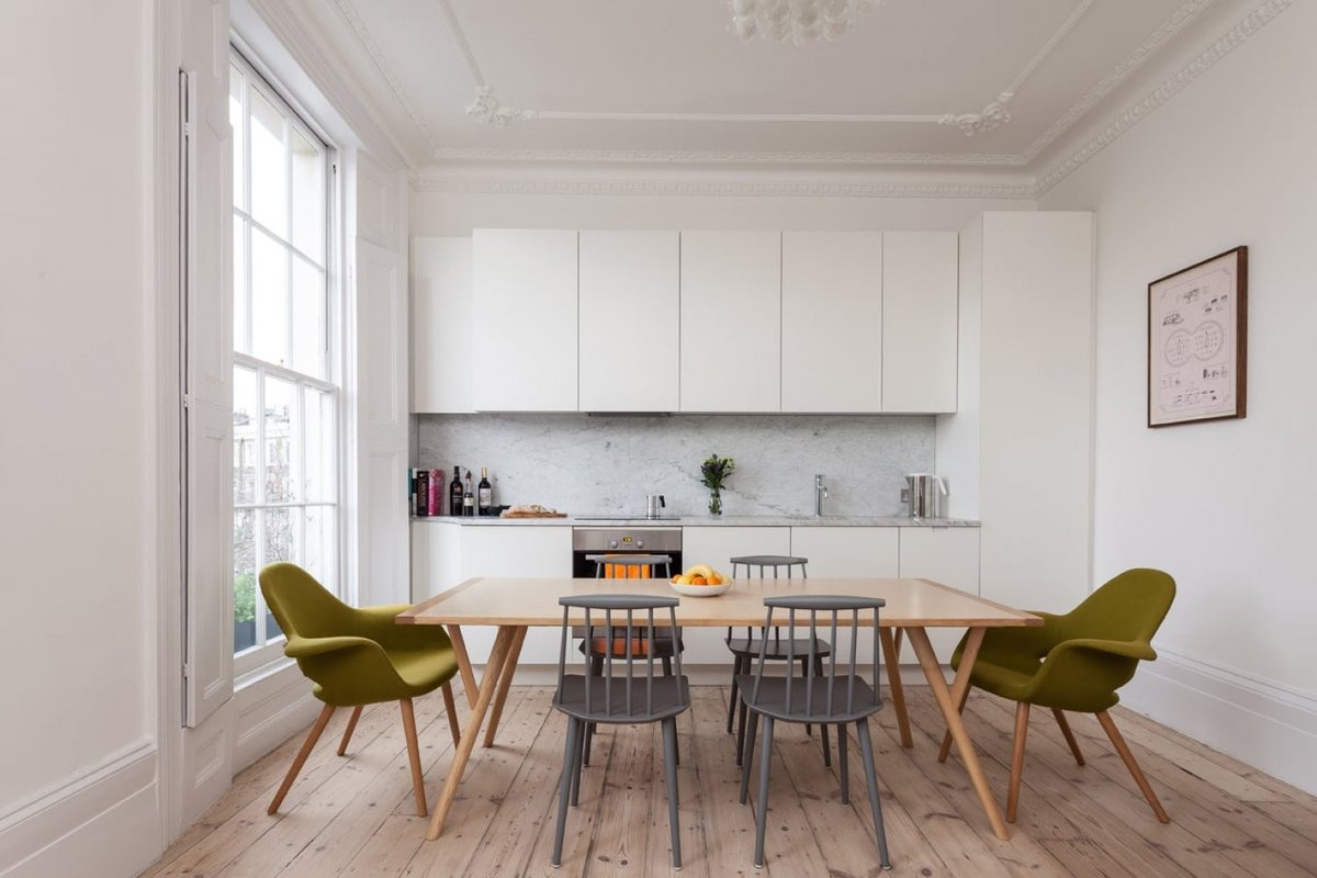 Scandinavian Style Kitchen: Interior Decoration and Furniture Ideas. Large dining zone right at the kitchen with colorful chairs