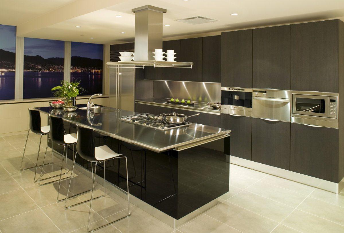 Black designed kitchen facades with steel inlays