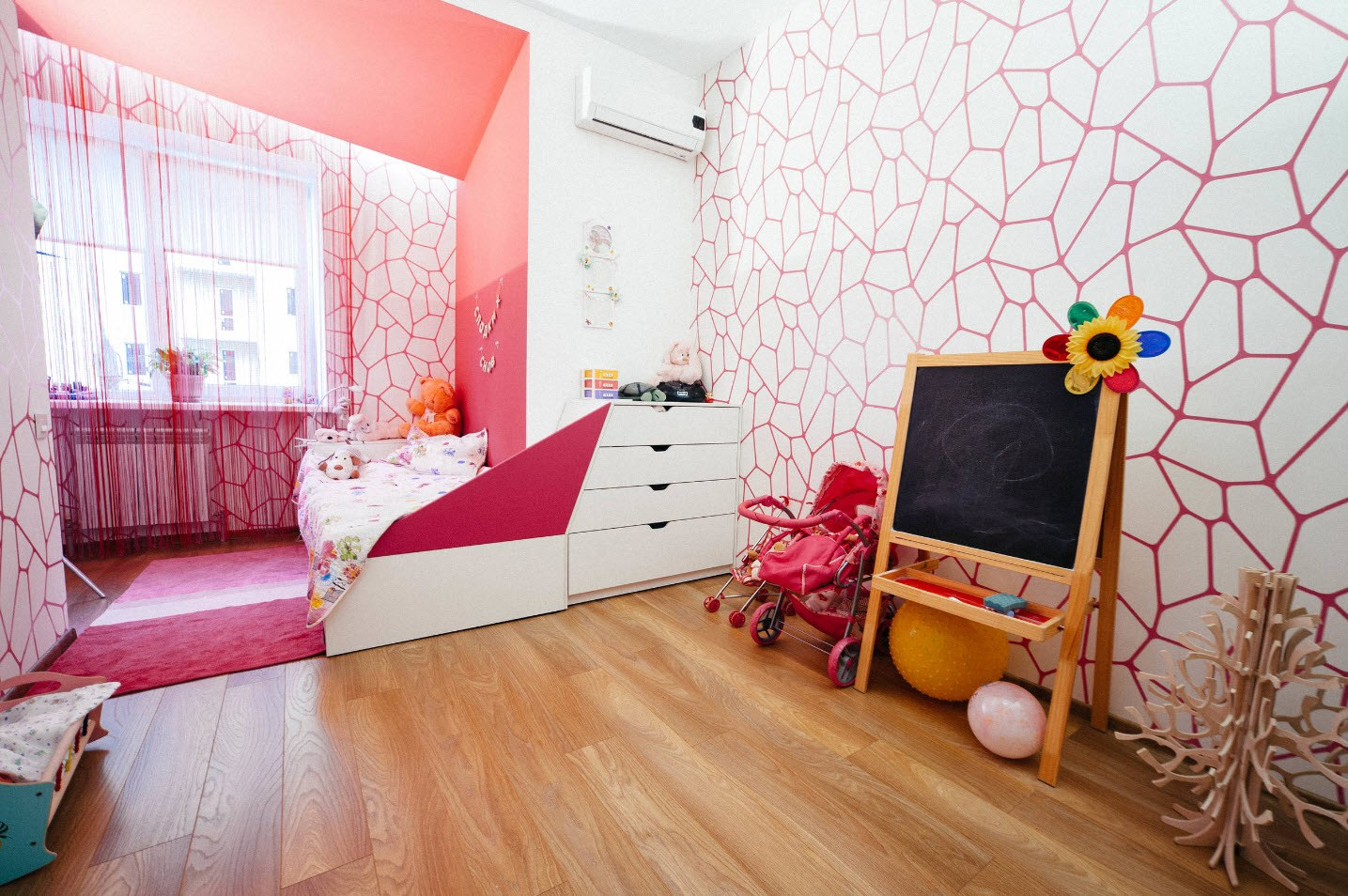 Kids' room with functional furniture and pink decoration of the balcony