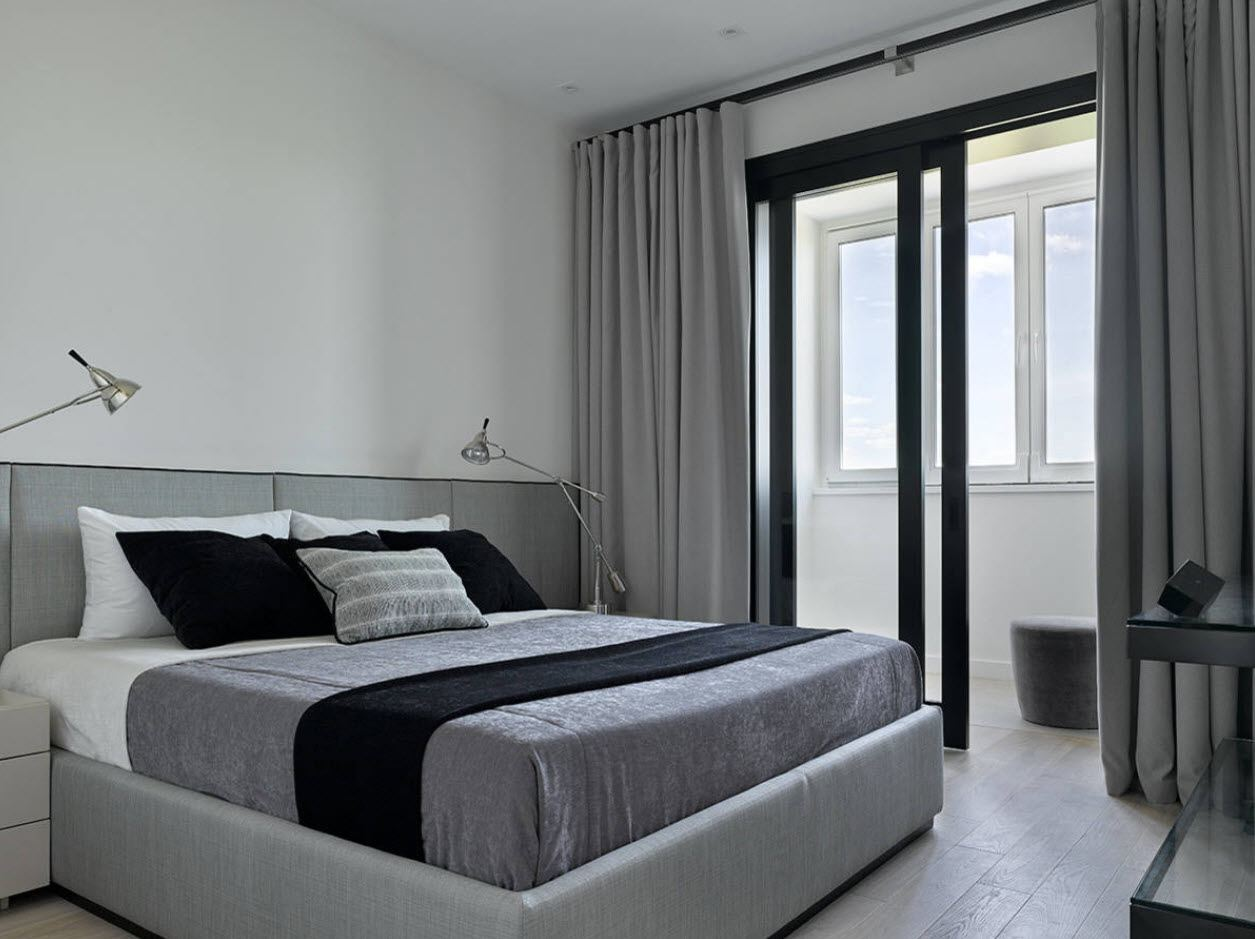 Platform bed in gray at the bedroom with balcony