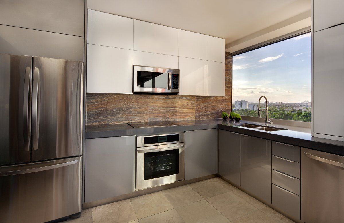 Small kitchen with panoramic window and different colors in the interior decoration